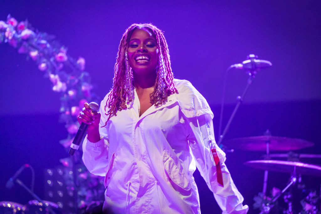 singer pj shown on stage performing at royale boston, opening for R&B artist pink sweat$